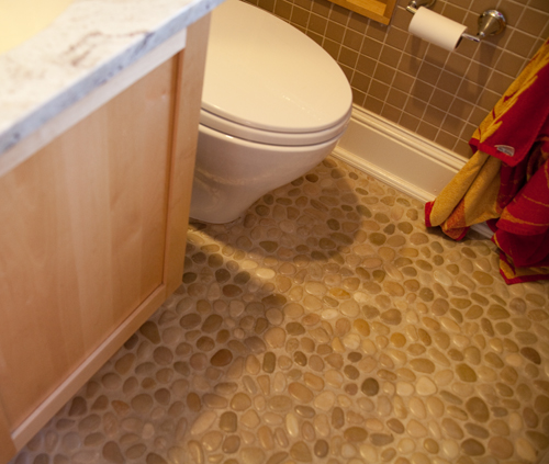 Green home renovation with storage galore diy del ray for Installing river rock tile