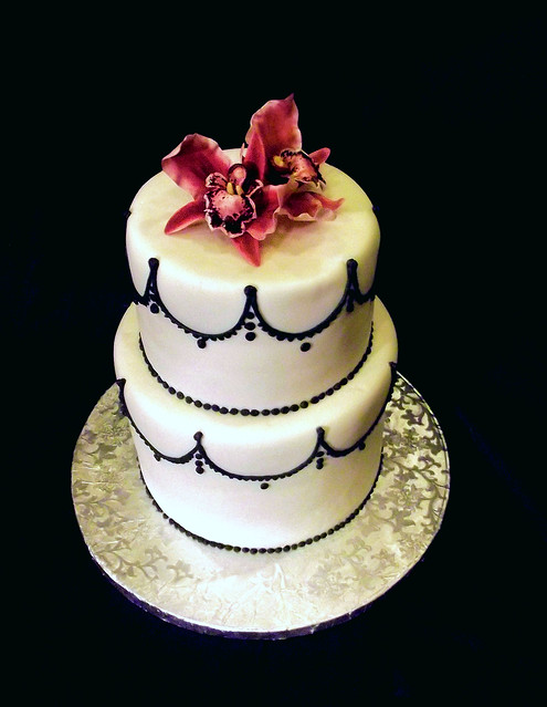Nov 4 2011 Black and white wedding cake with red orchid sugar flowers