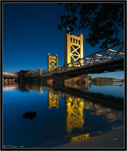 california bridge blue sky reflection tree tower water sunshine rock towerbridge sand postcard landmark olympus explore ripples sacramento e3 yolocounty sacramentocounty sacramentoriver westsacramento printsavailable zd zuikodigital olympuse3 918mm kitchen428