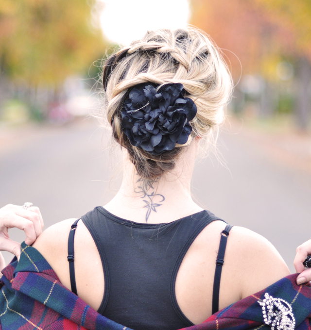 braided hair do-braids-plaits-black flower-neck tattoo-flower in hair