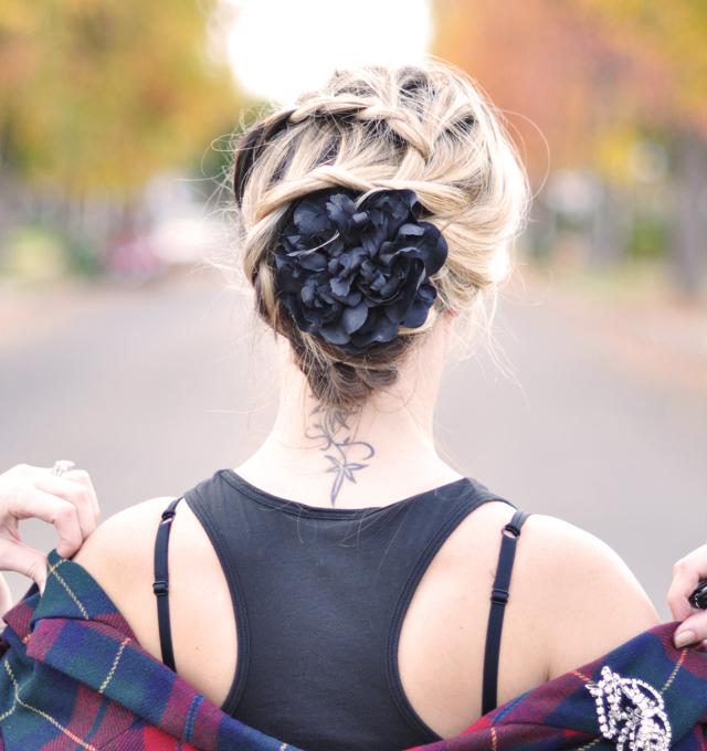 braided hair do-braids-plaits-black flower-neck tattoo-flower in hair