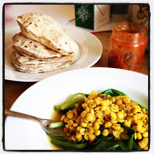 Very much a happy making lunch: @vegcs yellow pea dal and a big stack of fresh chapatti.