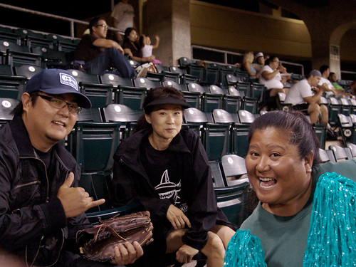 <p>Players and fans visited between games at the the UH AUW Softball Tourment at Les Murakami Stadium on Sept. 30, 2011</p>
