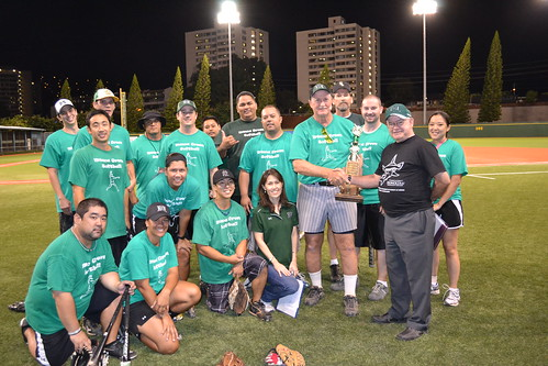 <p>Chancellor Mike Rota presents the trophy to the Manoa team at the the UH AUW Softball Tourment at Les Murakami Stadium on Sept. 30, 2011</p>