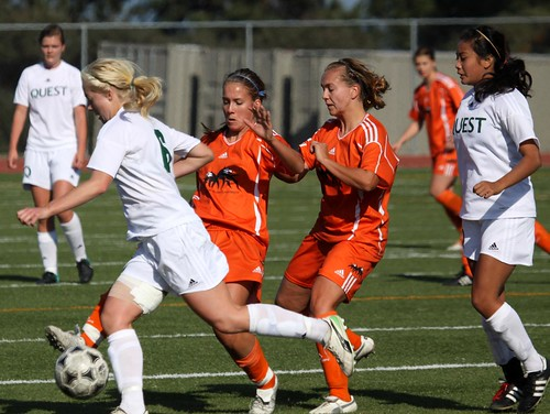 McAuley sisters on the ball vs Quest (horizontal Oct 15, 2011 Douglas Sage)