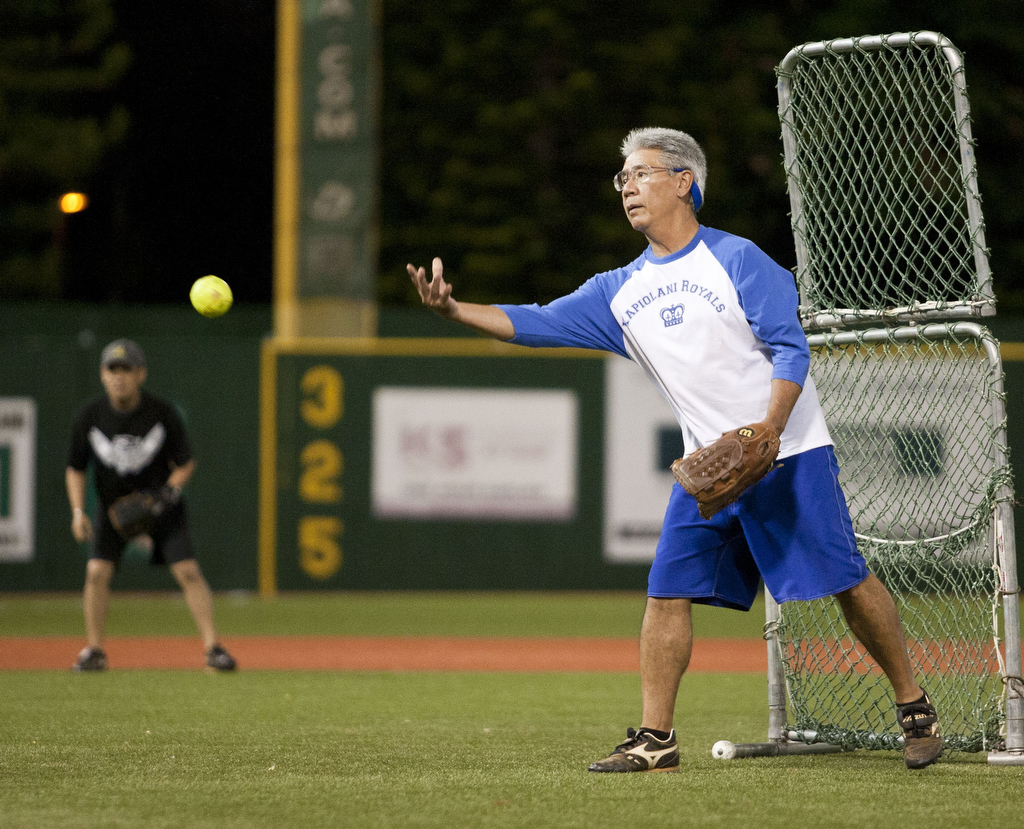 <p>A Kapi'olani Royals pitcher steps in front of the protective netting to pitch to his team's batters at the UH AUW Softball Tourment at Les Murakami Stadium on Sept. 30, 2011</p>