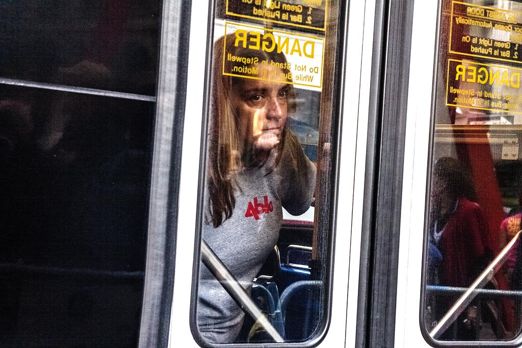 Woman-inside-bus-exit--Manhattan