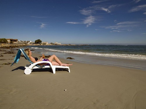 Woman relaxing in deck chair at Port Nolloth, Northern Cape