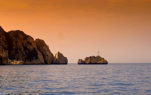 A Cross on the Rock by the Sunrise