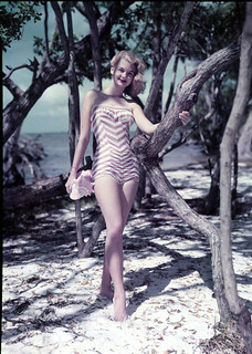 Unidentified young woman modeling by the beach