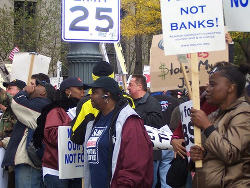 Thousands demonstrated in downtown Detroit on October 14, 2011 against the role of the banks in the economic crisis. Many have occupied Grand Circus Park since the march. (Kris Hamel) by Pan-African News Wire File Photos