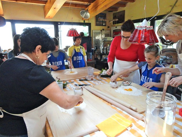planning group trips to italy family cooking class