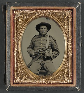 [Unidentified soldier in Confederate frock coat and slouch hat with Bowie knife and Colt Army Model 1860 revolver] (LOC)