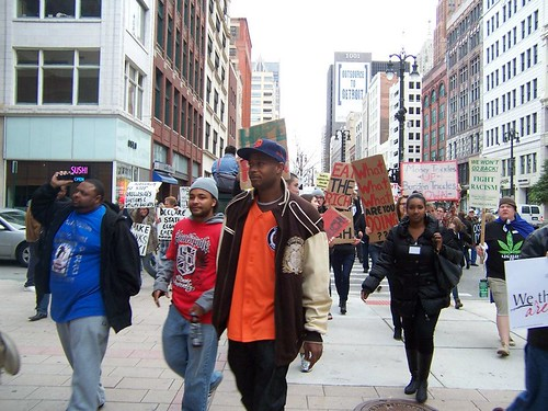 Youth and students were the majority of the crowd of thousands that marched through downtown Detroit as the part of the Occupation Wall Street movement. Grand Circus Park has been occupied since October 14, 2011. (Kris Hamel) by Pan-African News Wire File Photos