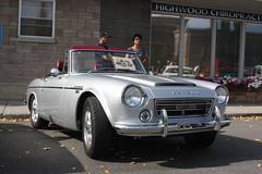 triumph tr250(0.0), triumph tr5(0.0), sunbeam tiger(0.0), triumph tr4(0.0), automobile(1.0), vehicle(1.0), datsun roadster(1.0), antique car(1.0), classic car(1.0), vintage car(1.0), land vehicle(1.0), convertible(1.0), sports car(1.0),