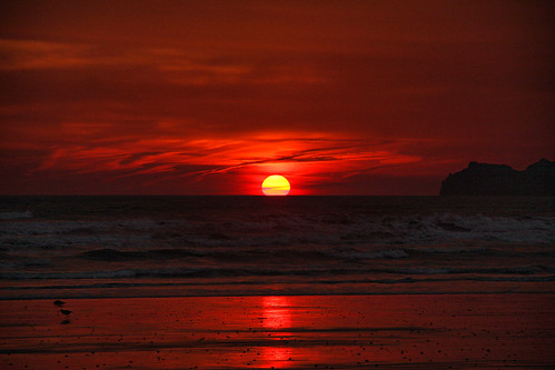 ireland red sea irish sun eye beach water shop clouds sunrise coast sand rocks waves east irelands portmarnock curlews