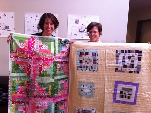 Daniela and Minda of Mercy Corps with some of the QfQ quilts she bought!