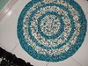 Crocheted rug of T-shirts