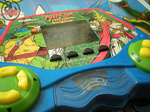 "TIGER ELECTRONICS :: ""NINJA TURTLES: THE NEXT MUTATION"" ELECTRONIC LCD GAME ii (( 1998 ))"
