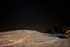 A freezing night of winter at Gulmarg. Stars, snow, light and shadow and a trail towards unknown destination