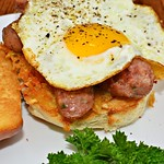 Mmm... fried egg, sliced sausage, and hash browns on a grilled bun