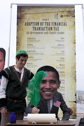 Oxfam activist as Pres. Obama poses with Robin Hood