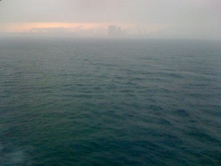 In a distance. Coast of Miami.