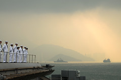 HONG KONG (Nov. 14, 2011) Sailors aboard the aircraft carrier USS George Washington (CVN 73) man the rails as the ship departs Hong Kong following a five-day port visit. (U.S. Navy photo by Mass Communication Specialist Seaman Erin Devenberg)