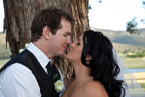 Artistique Photography by Nicolette - kissing bride and groom.