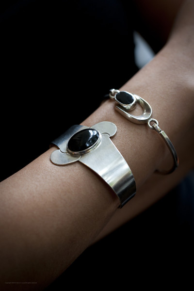 From left: Chunky silver cuff with onyx stone, marked Mexico, TB-44, 925; Thinner silver bangle with onxy stone, marked Mexico, TP-75, 925.