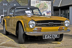 automobile, vehicle, antique car, classic car, vintage car, land vehicle, triumph tr6, convertible, sports car,