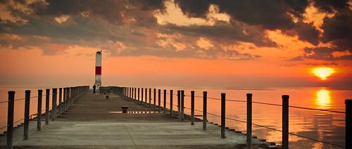 light sky sun newyork beach water beautiful clouds sunrise landscape pier interesting nikon warm scenic peaceful calm rochester 1855mm waterscape beachscape leadinglines d3000