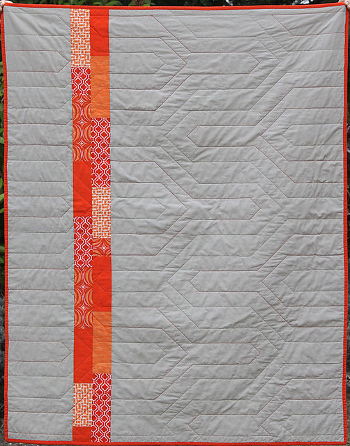 Back view of the Modern Chevron Baby Quilt, showing the quilting pattern