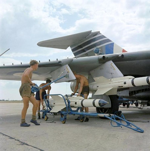 Ground crew load Firestreak missiles on to a Gloster Javelin FAW.9 of No 64 Squadron RAF at RAF Tengah.
