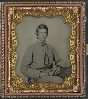 [Unidentified soldier in Confederate private's uniform with cased photograph] (LOC)