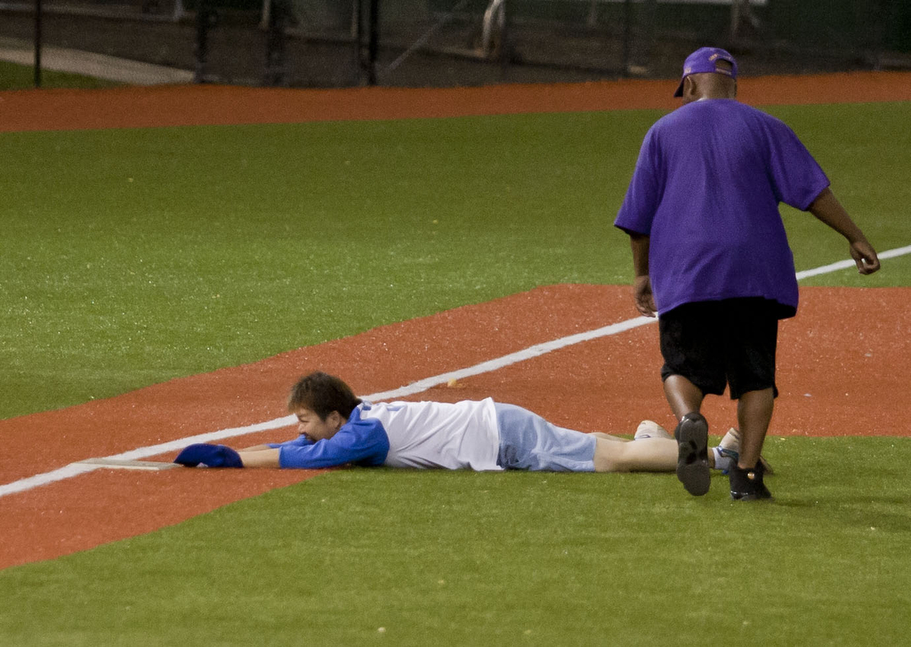 <p>A Kapi'olani player was safe at third base in the UH AUW Softball Tourment at Les Murakami Stadium on Sept. 30, 2011</p>