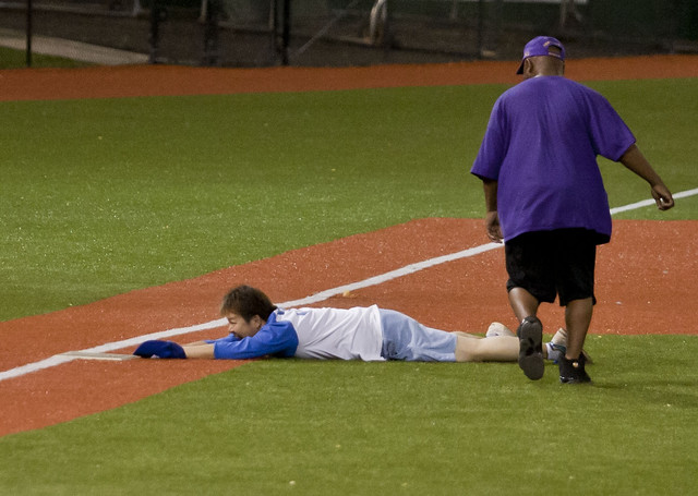 <p>A Kapi'olani player was safe at third base in the UH AUW Softball Tourment at Les Murakami Stadium on Sept. 30, 2011</p>