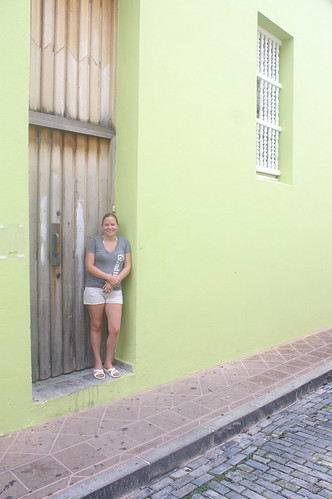 Rebecca in a colorful doorway in San Juan
