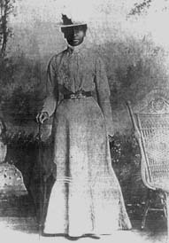 Portrait of Mary Elizabeth Bowser in long dress, with hat and cane