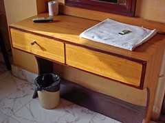 furniture(0.0), chest of drawers(0.0), table(0.0), bed(0.0), nightstand(0.0), sink(0.0), drawer(1.0), wood(1.0), room(1.0), hardwood(1.0), desk(1.0),