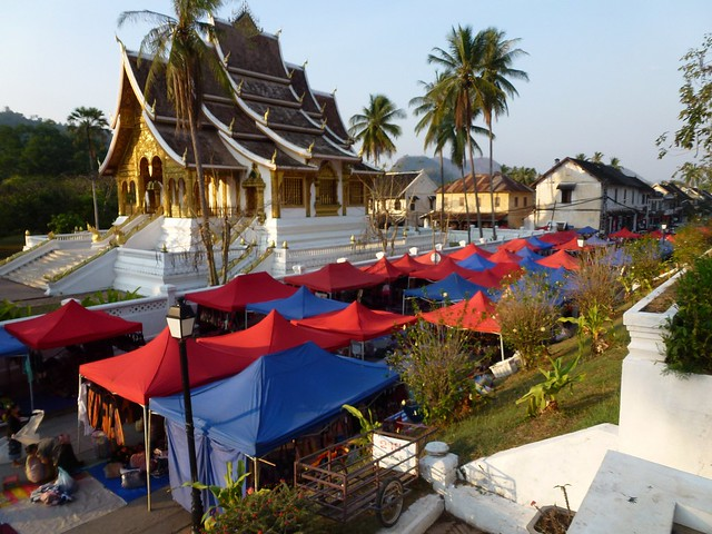 The night market set up with the Haw Pha Bang temple at the Royal Palace in the background