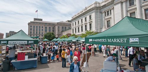 patrons enjoy a sunny afternoon at the USDA Farmers Market