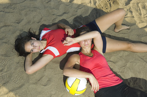 Sisters Relaxing on Beach Volleyball