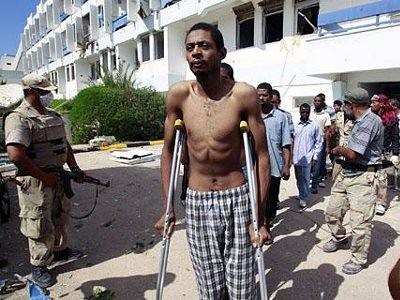 African prisoners being brutalized and tortured by NTC NATO-led rebels in Libya. A coalition of capitalist states coordinated by the US has waged war in the country since Feb. 2011. by Pan-African News Wire File Photos