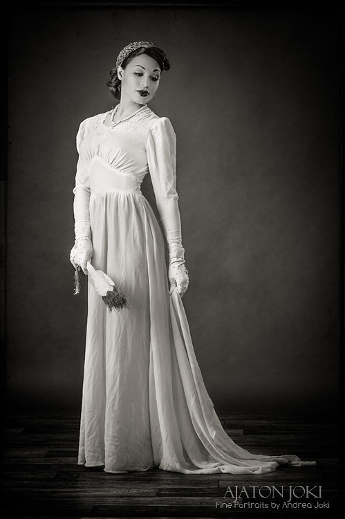 beautiful 1930s vintage bias cut bridal dress in studio