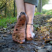 Barefoot on autumn leaves by Barefoot Adventurer