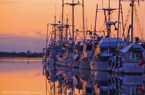 sunset reflection boats bc columbia british steveson blinkagain