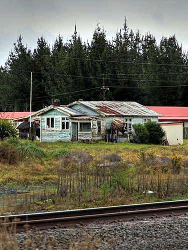 An old house on the other side of the tracks.  T...