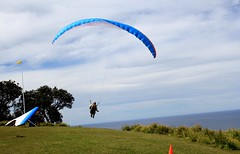 powered paragliding(0.0), gliding(0.0), toy(0.0), paragliding(1.0), parachute(1.0), air sports(1.0), sports(1.0), parachuting(1.0), windsports(1.0), extreme sport(1.0), sky(1.0), sport kite(1.0),