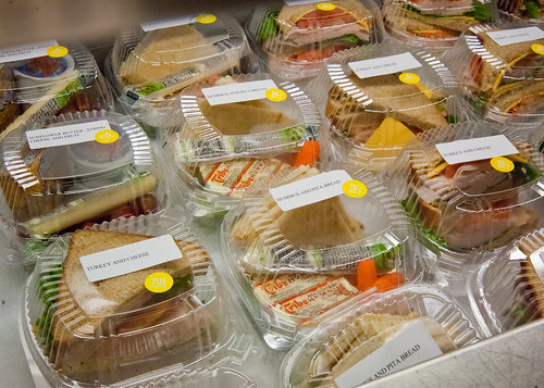 Hummus and Pita Bread, Sunflower butter string cheese and fruit, Turkey and cheese sandwiches prepared for the National School Lunch Program at Washington-Lee High School in Arlington, Virginia.